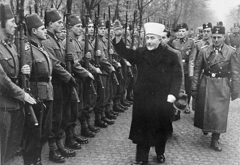 The Grand Mufti of Jerusalem and SS officers inspect a batalion of Muslim sturmtroopers in Croatia.