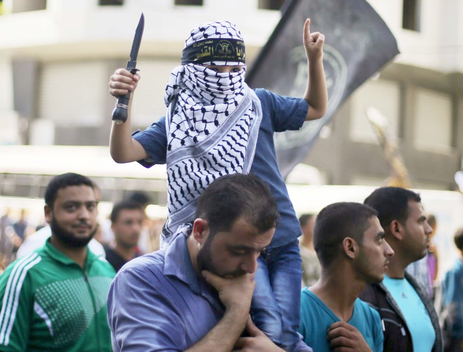 Deceived by Koran based Jew-hate, the Arabs parade their children holdimg knifes.
