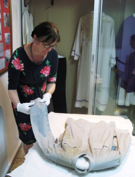 Stonyhursts curator Jan Graffius, preserving Monseñor Romeros shirt. (s)
