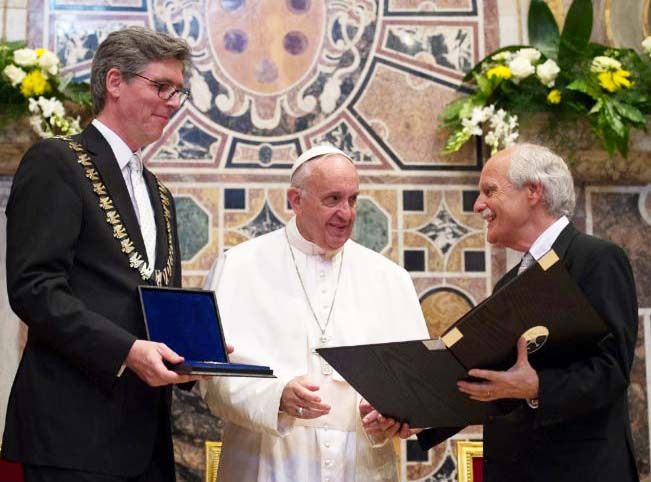 The Pope is awarded the Charlemagne prize, named after th seond Holy Roman emperor of Europe.