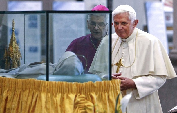 Pope Benedict XVI views the mummified body of Santa Rosa in her shrine during a visit to Viterbo
